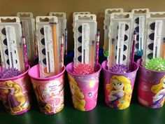 Rapunzel party favors. Paint labels from pagingsupermom.com. Pencils, light up bouncy balls, watercolors and note pads inside plastic cups.
