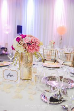 This Elegant 60th Birthday Celebration with custom painted Entrance signs, white carpet and gold bollards, rose gold sequins on the dry bars and marble tables with blush pink floral posies and gold mercury tealights. A bold arbour, draped in blush pink satin and crystal chandeliers, with guest tables having its own delicate floral centrepiece in bold gold vases. The room was filled with blush, nude and clear geronimo balloons with gold metallic tassels. Wedding Reception Styling Ideas.