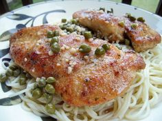 Chicken Piccata - no one will ever guess how easy this is! With a few simple ingredients you can make a restaurant quality meal! Chicken, garlic, butter, lemon and capers. Ready in under 20 minutes!