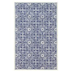 Wool rug with a royal blue medallion motif. Hand-tufted in India.  Product: RugConstruction Material: Wool