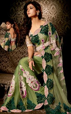 Breathtaking collection of sarees with stylish embroidery work and fabulous style. This aloe vera green net saree is nicely designed with embroidered patch work is done with resham, zari, stone and lace work. Beautiful embroidery work on saree make attractive to impress all. This saree gives you a modern and different look in fabulous style. Matching blouse is available. Slight color variations are possible due to differing screen and photograph resolution.