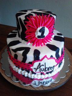 Pink and zebra print girl birthday cake