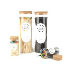 216 matches in a glass tube with a cork top and a strike pad on the bottom.    Also available in a tall glass version or in cardboard tubes of 48.