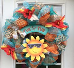 Summer deco mesh wreath with an adorable fun in the sun sign, hydrangea's, lots of ribbon. Teal, aqua and orange on Etsy, $65.00