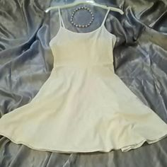 NWT ~ Forever 21~ lil white skater dress Brand new... cute, sweet and simple solid white Cami style skater  dress.. Cotton/spandex blend.  I'm also including a red and white seashell choker necklace for free :) Forever 21 Dresses Mini