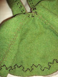 Birka inspired embroidery using 3-ply handspun thread on a Skjoldehamn style hood. By Brynja>>this fabric is remarkably like that mystery green stuff I have!