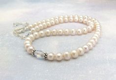 Beautiful Cream White Freshwater Pearl Necklace!  Real pearls, beautiful luster...    With a sparkling Swarovski Crystal at the center, and Sterling