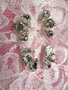 (Set of 4) Crystal Rhinestone Appliques Silver Setting     Size: 3/4\ each at widest point.     Appliques are Handmade, all measurements are approximate.        Application: Sew, glue or Iron on    You will receive four pieces as shown in photo for 2.99.