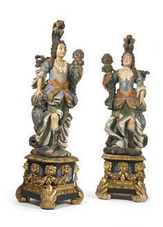 A pair of Luso-Brazilian Baroque polychrome painted torchères 18th century