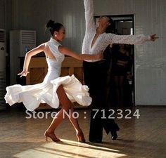 Beautiful White Latin Dress with Gorgeous Flare Résultats Google Recherche d'images correspondant à http://i00.i.aliimg.com/wsphoto/v0/603369374_1/Free-shipping-Latin-salsa-Cha-cha-tango-Ballroom-Dance-Dress-white-skirt.jpg