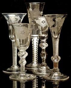 "Jacobite Glasses, 18th century most often used for toasting Prince Charles Edward Stuart (""Bonnie Prince Charlie""). The Jacobites were supporters of the exiled King James II who abdicated in 1698, and of his descendants James Edward Stuart (the ""Old Pretender"") and his son Charles Edward Stuart (the ""Young Pretender"")."