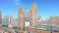 """MVRDV unveils pair of stone towers for The Hague topped with """"crown of terraces"""""""