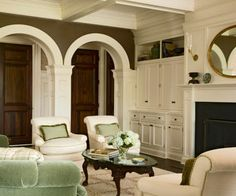 Dramatically beautiful -- dark walls with lots of white woodwork and light furniture; built-ins; coffered ceiling; arches; molding  *love*