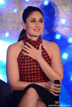 <p>Trust the Kapoor girl to floor you with her fashion choices and she definitely won't disappoint. During the promotions of <i>Bajrangi Bhaijan, </i>Bebo stepped out in a plain black pencil skirt, which she teamed with a red-black polo neck top. Pale pink lips and a sleek ponytail completed her look.</p>