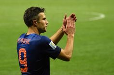 Netherlands' forward and captain Robin van Persie celebrates at the end of the third place play-off football match between Brazil and Netherlands during the 2014 FIFA World Cup at the National Stadium in Brasilia on July 12, 2014. Netherlands won 3-0