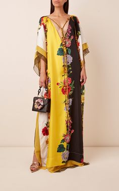 Oscar de la Renta's caftan is simple yet stunning, featuring a plunging v-cut neckline and a gorgeous floral print throughout. It's a billowy, jaw-dropping piece that flows well with gold-tone hoop earrings and strappy sandals. Mode Abaya, V Cuts, Silk Satin, Cool Designs, Kimono Top, Floral Prints, My Style, How To Wear, Clothes