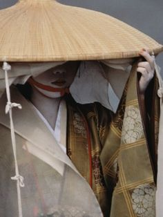 "Draped for privacy in the traveling clothes of a 12th-century noblewoman, a geisha walks in Kyoto's annual Festival of the Ages."" photo by Jodi Cobb, National Geographic, October 1995"