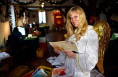 An actress dressed as the Christkind poses in a Deutsche Post retail outlet in Engelskirchen, Germany. Getty Pic