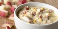 Corn Chowder garnished with bacon and chive.