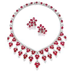 RUBY AND DIAMOND NECKLACE floral necklace composed of eighty-nine oval rubies, decorated by marquise-, pear-shaped and brilliant-cut diamonds, suspending from a brilliant-cut diamond necklace, length approximately 410mm; and pair of matching ear clips each composed of ten oval rubies, decorated with marquise-, pear-shaped, and brilliant-cut diamonds, clip fittings; the rubies and diamonds altogether weighing approximately 117.00 and 41.25 carats r
