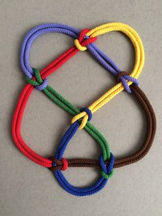 Here is the 6-2 knot as created using my knotted-cord technique. Anyone wondering yet how I get each colour to be a continuous loop? See http://katlas.math.toronto.edu/wiki/6_2 from which I have swapped over-crossings and under-crossings.
