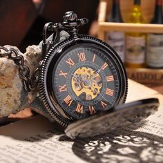 Excuse me, friend, have you got the time? No? Well, then- you obviously need to invest in this sleek, black, steampunk-style mechanical pocket watch. It won't break the bank and will give the perfect