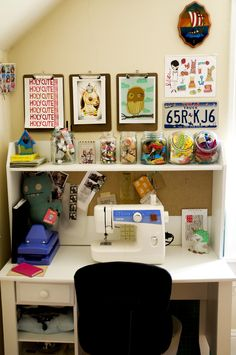 Craft and sewing nook - love the eclectic feel, and supplies stored in clear containers.
