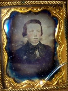 Antique Daguerreotype features a young boys portrait-It was hard to get a good photo of this so hope you can actually see the boy with rosy cheeks. The frame and gold metal mat are really nice. It mea