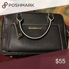 Nine West purse Black leather  purse. Lots of pockets. In great shape.  It comes with a removable strap Nine West Bags Shoulder Bags