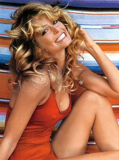 Farrah Fawcett, This iconic poster, released the same year Charlie's Angels premiered, broke sales records, making her an international pop culture icon. Her hairstyle was emulated by young women in the and Farrah Fawcett, Charlies Angels, L Icon, Beautiful People, Beautiful Women, Stunningly Beautiful, Beauty And Fashion, Red Swimsuit, Sexy Poses