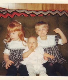 15 Awkward Sibling Photos--Sibling Rivalry--Guess which sister doesn't like the baby?