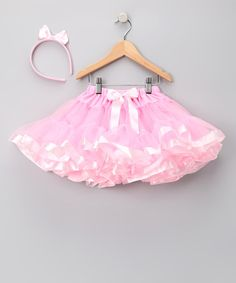 A precious little princess needs a royal outfit that's as perfect as she is, and this gorgeous pettiskirt and headband will do the trick. This fluffy skirt comes with an elastic waistband lending to a truly fairy-tale fit. Includes headband and pettiskirtFits ages 2 to 6 years100% polyester