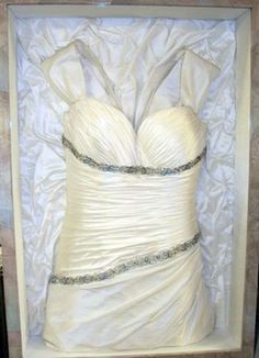 I wanna do this with my wedding dress Frame your wedding dress. If you look closely, the back of the frame is the bottom part of the dress! Great for dressing room or walk in closet, and so much better than packing it away! Wedding Dress Frame, Wedding Frames, Wedding Dresses, Wedding Dress Shadow Box, Wedding Bells, Our Wedding, Dream Wedding, Wedding Stuff, Wedding Pins