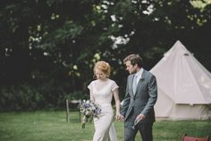 love the outdoor ceremony with bell tent village in the background
