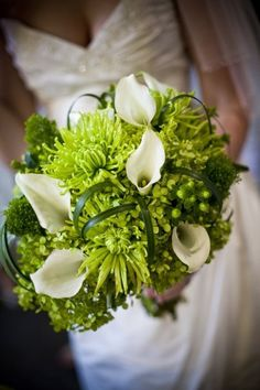 White callas take center stage in this luscious bouquet of green spiders, hydrangea and berries.