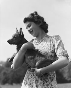 The Queen, with her pet Corgi, age 18. (1944)