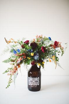 Gretchen Culver | growler table centerpiece with crawling flowers
