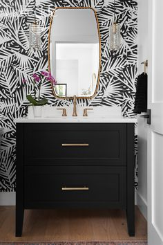 Bold wallpaper, gold accents and black cabinets make this powder room stand out. Powder Room Wallpaper, Bold Wallpaper, Black And White Wallpaper, Black Wallpaper Bedroom, Powder Room Decor, Powder Room Design, Powder Room Vanity, Black And Gold Bathroom, White Bathroom