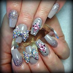Taupe nude coffin nails with giant crystal bows and bling
