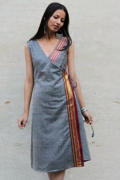 saree dress Grey Saree Wrap Dress in A-line silhouette with pocket on one side and tie up at the waist. Made using Indian traditional cotton silk saree. Length of the dress is 43 inches. Completely lined. Model is wearing size XS. Cotton Dress Indian, Dress Indian Style, Indian Fashion Dresses, Indian Designer Outfits, Cotton Dresses, Designer Dresses, Indian Outfits, Salwar Designs, Simple Kurti Designs