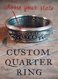 """These rings showcase state quarters in a unique way — which is to say, they're made from them. Each uncirculated quarter is hand-picked and formed into a ring. The front of the ring will have the state name, and the back of the ring will have the year the quarter was put into circulation. On the inside you will see """"United States of America"""" as well as """"E Pluribus Unum."""""""