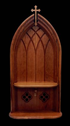 This home altar is freestanding and can be placed on a shelf or bureau.  A Holy Water font is an option for either the top or bottom shelf.