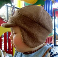 Fleece winter hat with visor and ear flaps for baby boys. $15.00, via Etsy.