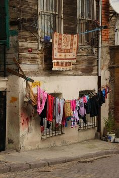 Washing in Zeyrek, an old Istanbul neighbourhood - I have a whole series of photographs of washing hung out on different days outside my hotel :) Line Photography, Street Photography, Turkey Culture, Colorful Apartment, Great Wall Of China, Washing Lines, Through The Looking Glass, Laundry Lines, Laundry Art