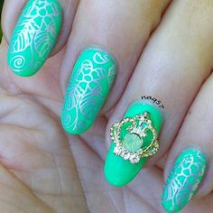silver flower on green stamping nail art design 5/30/2015