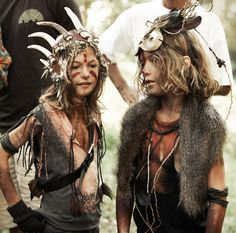 Ripped tshirts, belts, tassles, feathers, gloves, face paint, headdress, messy hair, things tied round arms, twig necklace...