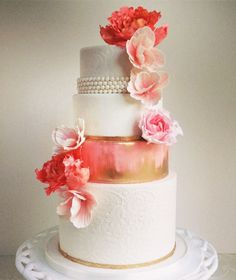 Beautiful, pink gold and white wedding cake, pearls, flowers. floral, simple, elegant
