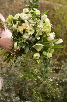 spring wedding flowers - a trailing bunch of spring flowers by Matthew Spriggs