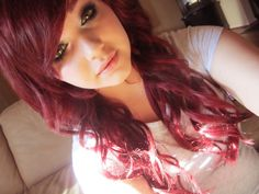 Maroon curly hair with bangs