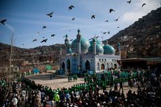 Hundreds of Afghans wait to see the holy flag at the Kart-e Sakhi mosque in Kabul, March 21, 2013.